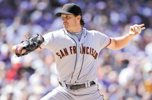 DENVER, CO - APRIL 09: Starting pitcher Barry Zito #75 of the San Francisco Giants delivers against the Colorado Rockies on Opening Day at Coors Field on April 9, 2012 in Denver, Colorado.   Doug Pensinger/Getty Images/AFP== FOR NEWSPAPERS, INTERNET, TELCOS & TELEVISION USE ONLY ==